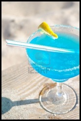 889933-blue-daiquiri-cocktail-on-beach